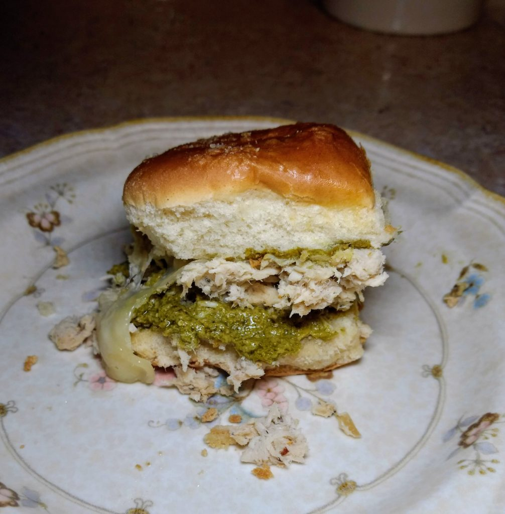 shredded chicken italian sliders with pesto on a plate
